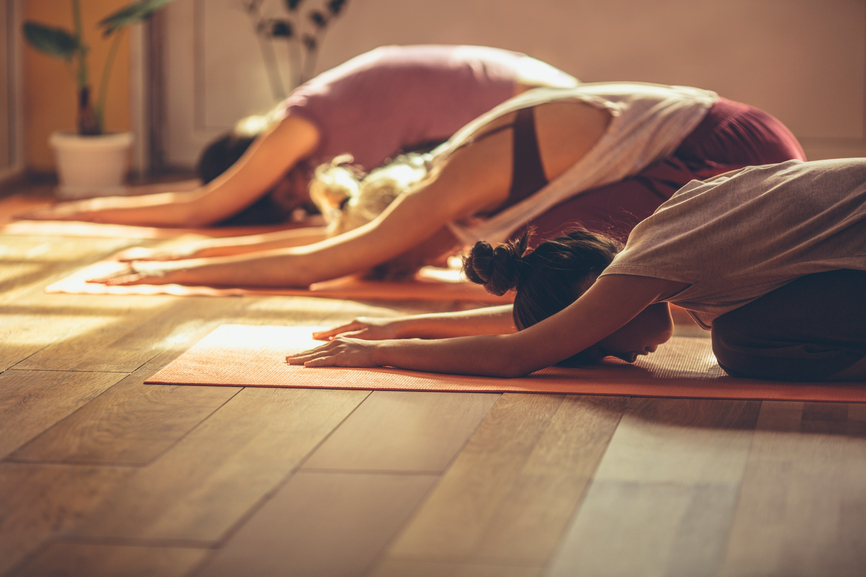 This image has an empty alt attribute; its file name is Monday-night-candlelight-yoga.jpg